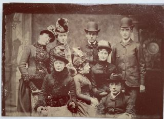 Dressed in Finery]--a Tintype Photograph of 8 young people. ANONYMOUS